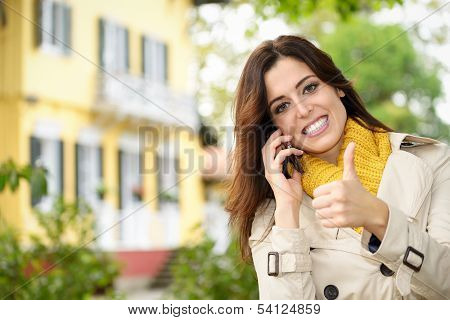 Positive Female Home Owner Calling By Phone