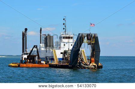Dredger on the Ocean inlet