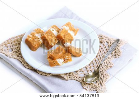 Sherbet with nuts on plate isolated on white
