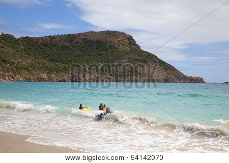 Children playing at Saline beach at St. Barths