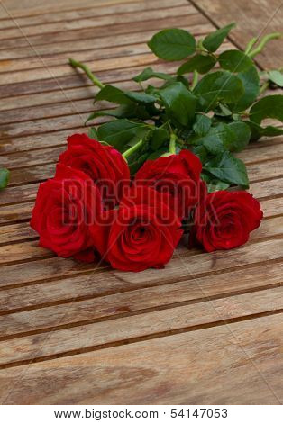 bouquet of red roses on table