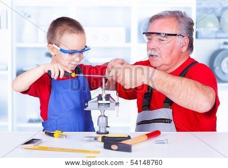 Grandfather Teaching Grandchild Rasping