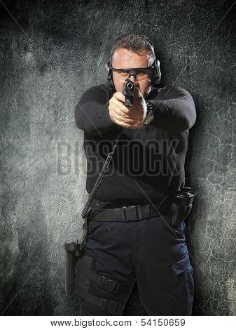 Man shooting hand gun