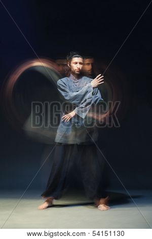 Man in kimono excercising Martial Arts