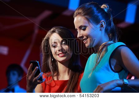 Two Women Enjoying With A Smartphone
