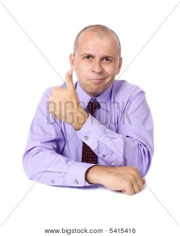 Smiling Businessman Showing Thumb Up