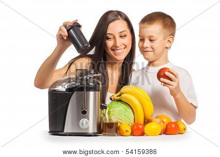 happy family are pressing the juice from the fruit