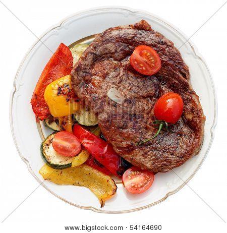 Kobe beef ribeye steak with grilled vegetables on old table