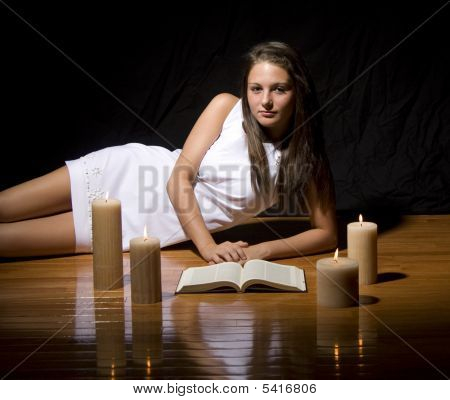 Girl In White Dress Laying On Wood Floor