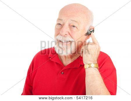 Senior Man Using Hands Free Set