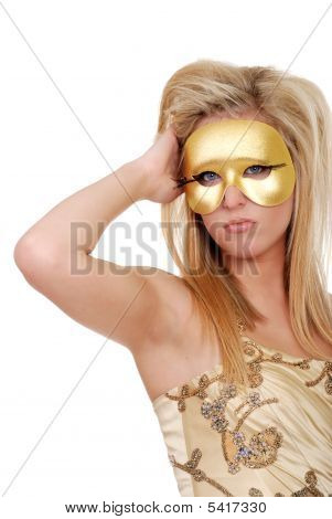 Young Blond Woman With Blue Eyes And  A Golden Mask
