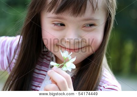 Portrait Of Beautiful Girl With Flowers In Park