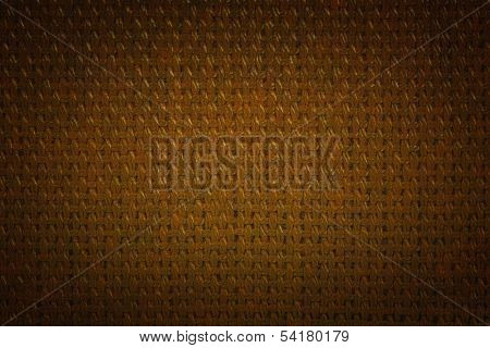 Coarse brown color fabric with a dark vignette.
