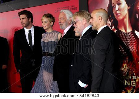 LOS ANGELES - NOV 18:  L Hemsworth, J Lawrence, D Sutherland, J Hutcherson, Phillip Seymour Hoffman, S Tucci at the Catching Fire Premiere at Nokia Theater on November 18, 2013 in Los Angeles, CA