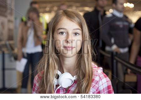 Teenage Girl In Airport Travelling