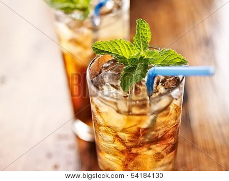iced sweet tea with blue straw