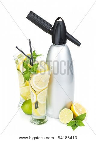 Glasses with homemade lemonade and siphon. Isolated on white background