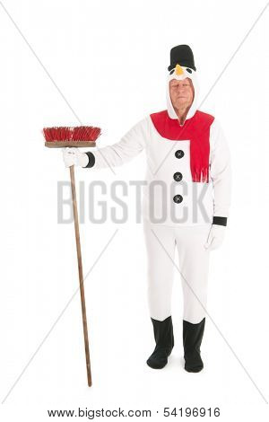 Human snowman is cleaning the street with broom