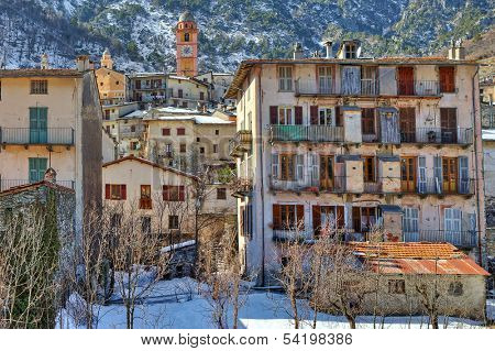 Old houses on the slope of the mountain in Tende - small alpine town on French - Italian border.