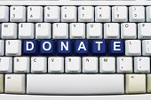 image of word charity  - Computer keyboard keys with word donate Making Donations on the Internet - JPG