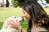 stock photo of mexican-dog  - A pet owner showing that she loves her dog - JPG