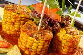 stock photo of sweet-corn  - Baked corn with salsa and tortila chips - JPG