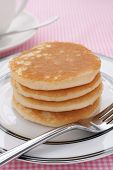 stock photo of buttermilk  - Stack of plain buttermilk pancakes no butter or syrup - JPG