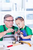 pic of vernier-caliper  - Grandfather teaching grandchild measuring with vernier caliper - JPG