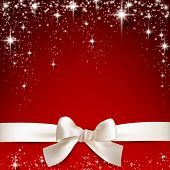 foto of starry  - Gift white ribbon with bow over red starry christmas background - JPG