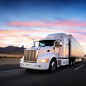 stock photo of travel trailer  - Truck and highway at sunset  - JPG