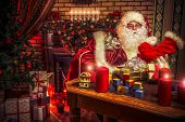 pic of nicholas  - Santa Claus making Christmas gifts at home - JPG