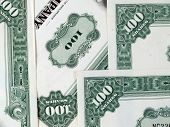 picture of debenture  - a few common stock certificates of a big american company  - JPG