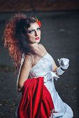 pic of carnal  - Attractive bride in a wedding dress with bright makeup red shawl  - JPG