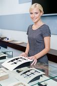 image of jewel-case  - Salesperson at the window case with rings at jeweler - JPG
