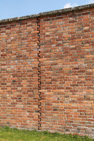 stock photo of mortar-joint  - An Expansion Joint in a Traditionally Built Brick Wall - JPG