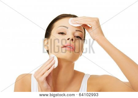 Beautiful woman using cotton pad , isolated on white