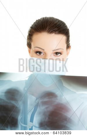 Female doctor or nurse looking at radiography photo , isolated on white