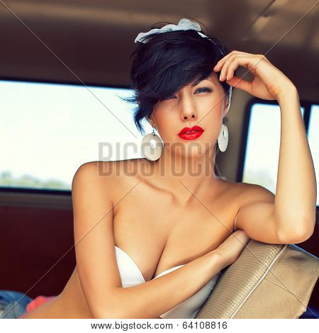 A Beautiful Retro-looking Girl With Blue Eyes And Red Lips