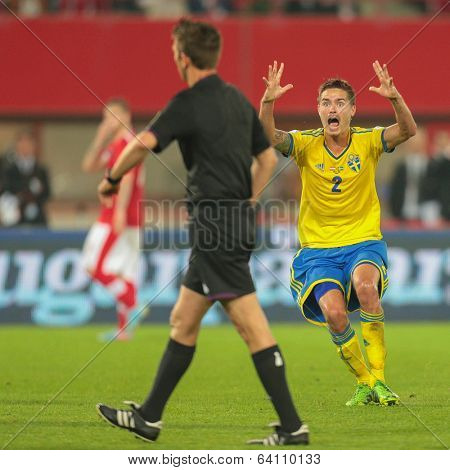 VIENNA,  AUSTRIA - JUNE  7 Mikael Lustig (#2 Sweden), complains to Referee Gianluca Rocchi (Italy) during the world cup qualifier game on June 7, 2013 in Vienna, Austria.