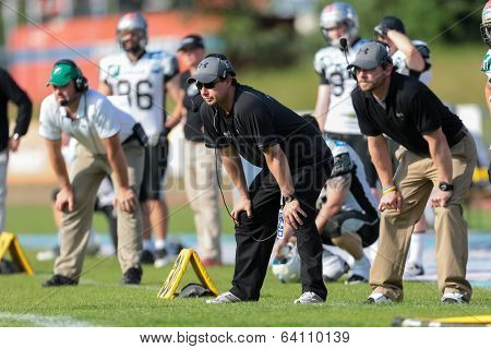VIENNA,  AUSTRIA - JUNE 8 Head Coach Shuan Fatah (Raiders) observes his players during the AFL football game on June 8, 2013 in Vienna, Austria.