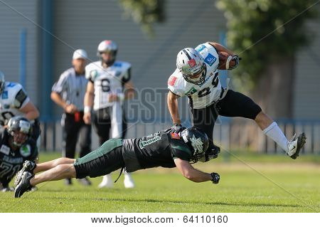VIENNA,  AUSTRIA - JUNE 8 DB Schahin Gholami (#21 Dragons) tackles RB Andreas Hofbauer (#29 Raiders) during the AFL football game on June 8, 2013 in Vienna, Austria.
