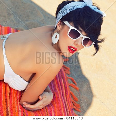 A Beautiful Young Girl In Retro Look With Red Lips In A White Swimsuit, A Bandana And Sunglasses