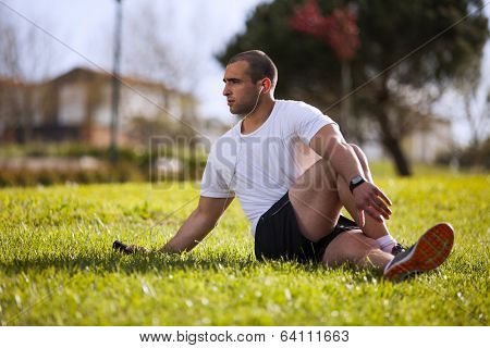 Man exercising at the city garden