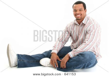 Handsome Male Sitting On Floor