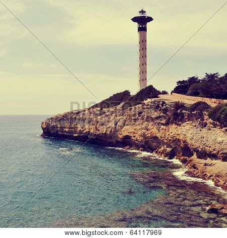 view of a lighthouse in Torredembarra, Spain, with a retro effect