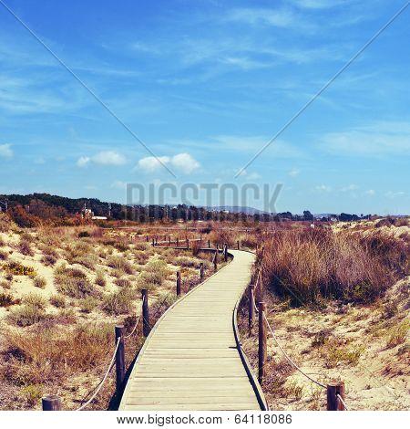 boardwalk in Els Muntanyans natural park in Torredembarra, Spain, with a retro effect