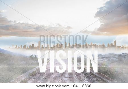 The word vision against rocky path leading to large urban sprawl