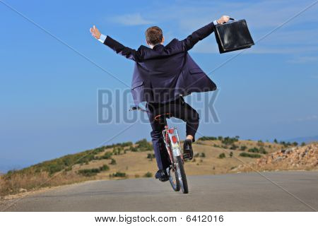 Businessman Riding A Bike Outside
