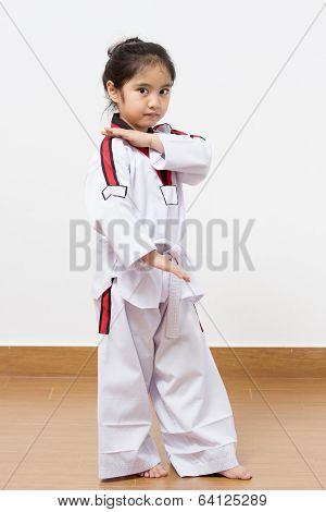 Little asian child in fighting action