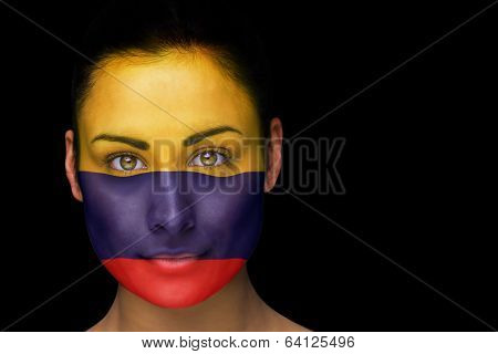 Composite image of colombia football fan in face paint against black